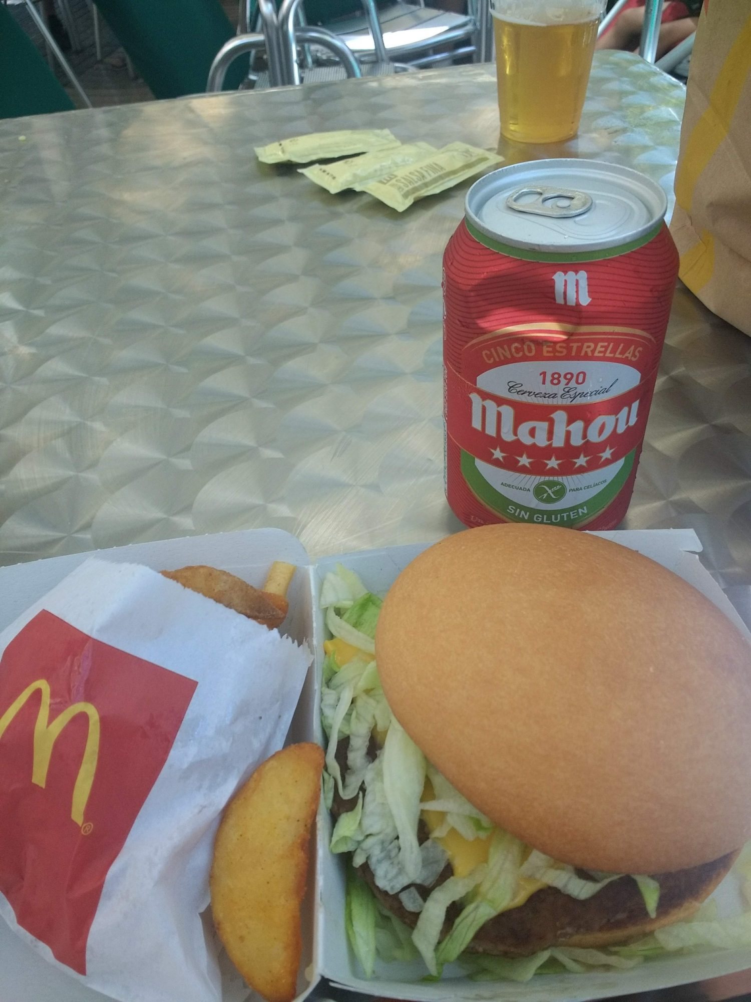 Gluten Free Big Mac at a Spanish Mcdonalds, served with patatas and a gluten free Mahou.
